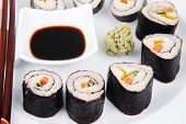 Постер, плакат: Maki Sushi : Maki Rolls and California rolls made of fresh raw Salmon sake Tuna maguro and Eel un