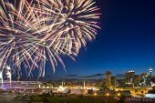 stock photo of grandstand  - Calgary Stampede fireworks with downtown in the background - JPG