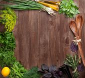 image of condiment  - Fresh garden herbs and condiments over wooden table - JPG