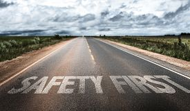 picture of unsafe  - Safety First written on rural road - JPG