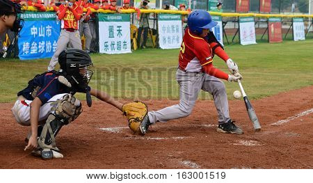 ZHONGSHAN GUANGDONGChina - October 28:unknown batter about to miss the ball in a baseball game on October 28 2016.