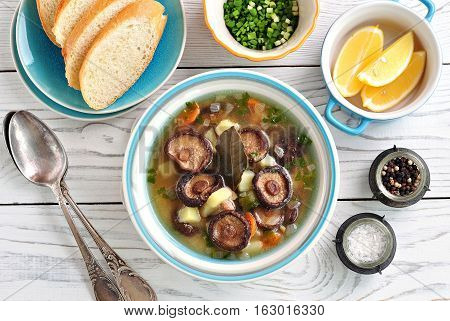 Soup with dried mushrooms shiitake with, potatoes, carrots and semolina.