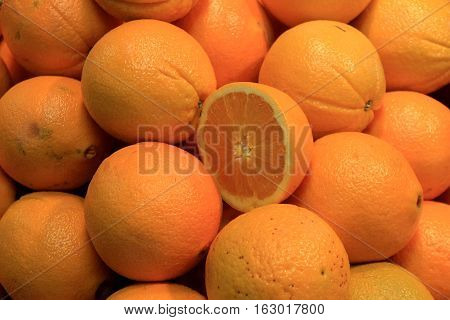 Group of oranges in crate at local market