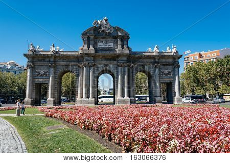 Madrid Spain - September 18 2016: Alcala´s Gate is a Neo-classical monument in the Square of independence in Madrid. It is the first modern post-roman triumphal arch built in Europe.