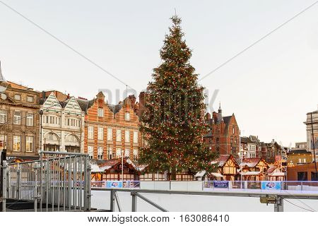 NOTTINGHAM ENGLAND - DECEMBER 26: Christmas tree and the Christmas market in Nottingham Market Square. In Nottingham England. On 26th December 2016.