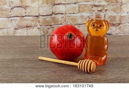 Jewish holiday jewish symbol Holiday symbo Jewish holiday Jewish new year. Rosh Hashana apples honey and pomegranates on a dark wood background traditional food for the Jewish new year. Rosh Hashana. selective focus on the middle of the honey