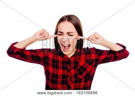 Angry Upset  Woman Covering Ears With Fingers And Screaming
