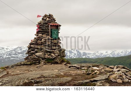 Cairn With Norway Flags On The Top Of Mountain In Lofoten, Norwa