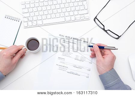 Hand Of A Man Calculating Home Bill Charges
