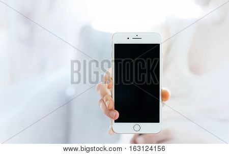 PARIS FRANCE - SEP 29 2016: Woman showing the new iPhone 7 plus smartphone. The New Apple iPhone tends to become one of the most popular smart phones in the world in 2016