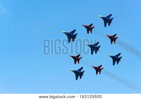 Famous Cuban diamond stunt performed by Su-27 and MiG-29 fighters during airshow in Russia