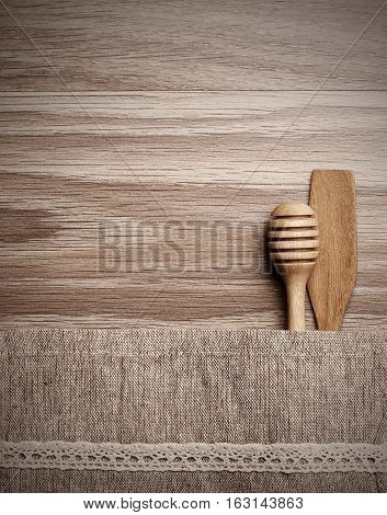 Wooden dipper kitchenware old wood board background