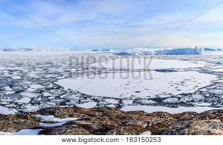 Ice fields and drifting Icebergs at the Ilulissat fjord North Greenland