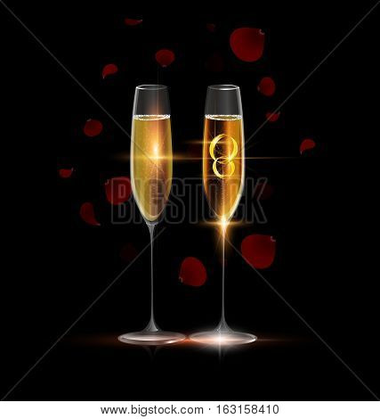 black background and two glasses of champagne with couple of golden jewel rings inside, red falling petals