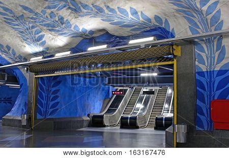 Escalators on T-Centralen station on the Blue Line designed by Per Olof Ultvedt in 1975 Stockholm, Sweden