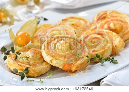 Baked hearty puff pastry rolls with smoked slamon, cream cheese and fesh herbs