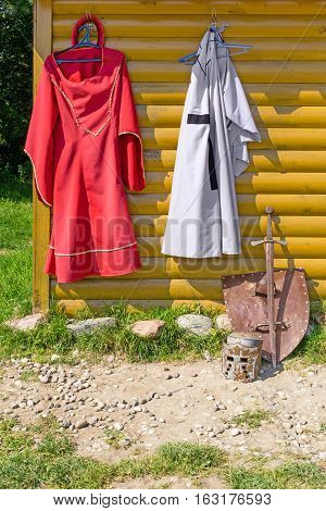 Knight Cloak And Dress On Wooden Wall