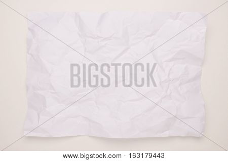 crumpled white recycle paper sheet on white background