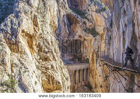 Malaga Spain - December 6 2016: Hiker man walking along the Caminito del Rey path Malaga Spain