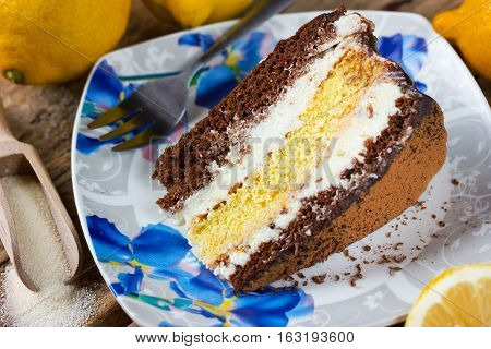 Slice of layer cake chocolate lemon semolina cake for a holiday party