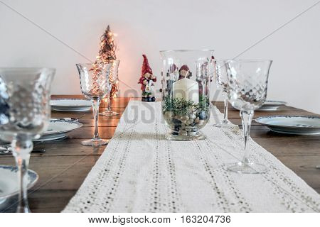 christmas decoration and tableware on wooden table