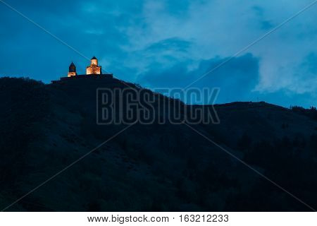 Evening View Of Gergeti Trinity Church Or Tsminda Sameba - Holy Trinity Church Near Village Of Gergeti In Georgia. Church Is Situated At An Elevation Of 2170 Meters, Under Mount Kazbegi.