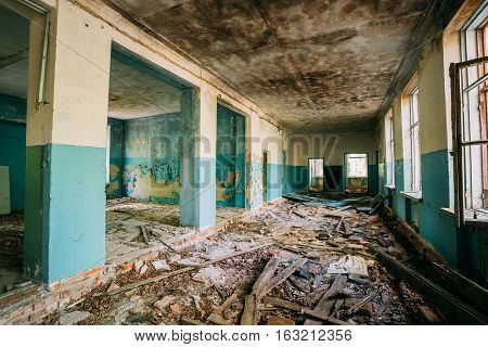 The Ruined Hall Of Abandoned Rural School After Chernobyl Disaster In Evacuation Zone. The Terrible Consequences Of The Nuclear Pollution Twenty Years Later.