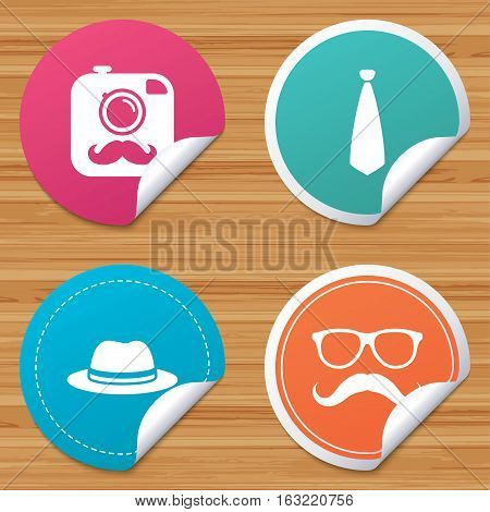 Round stickers or website banners. Hipster photo camera with mustache icon. Glasses and tie symbols. Classic hat headdress sign. Circle badges with bended corner. Vector