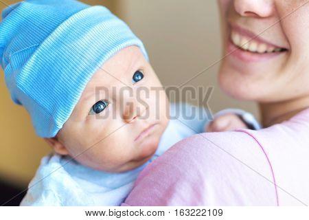 Cute newborn baby in mother's hands. Stock photo