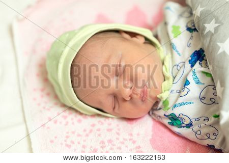 Cute Newborn Baby Sleeps In The Bed. Stock Photo