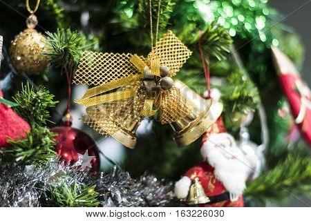Jingle bell and hanging on a Chrismas tree.