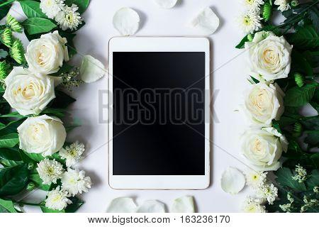 Fresh White Rose Flower And Tablet On White Background