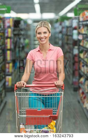 Beautiful Woman Shopping In A Grocery Store Supermarket