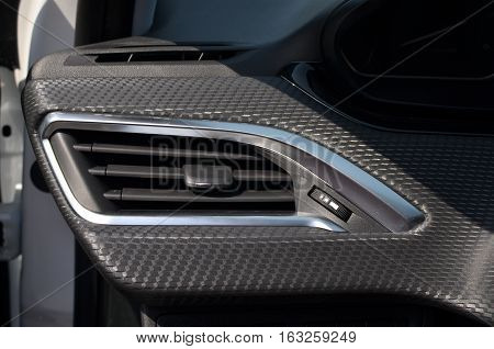 Air vent in a car interior on daylight