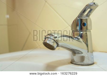 Modern bathroom washbasin with chrome water tap and washing toothbrush