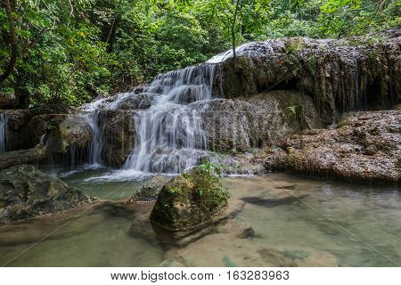 Deep forest waterfall in national park Thailand in rainy season(Erawan Waterfall)