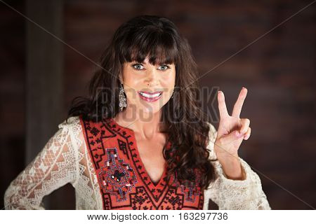 Smiling Woman Making A V Gesture