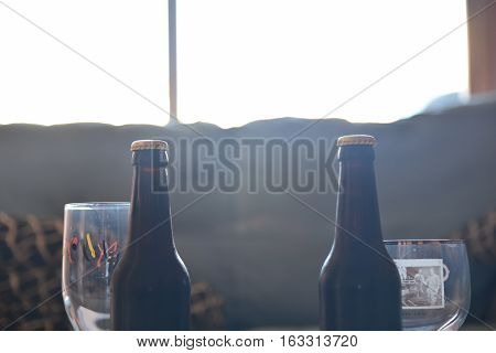 two bottle from craft black beer with beer glasses