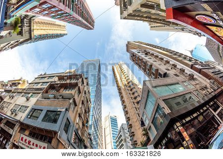 Hong Kong, China - December 4, 2016: fish eye lens view and perspective to high rise buildings in the popular and historic district of Soho in Hong Kong island between Staunton and Shelley Street.
