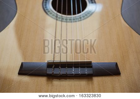Guitar on wooden background fretboard, musical instrument
