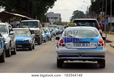 A car jam with colorful taxi cars in Pointe-Noire, Congo Republic, february 2015