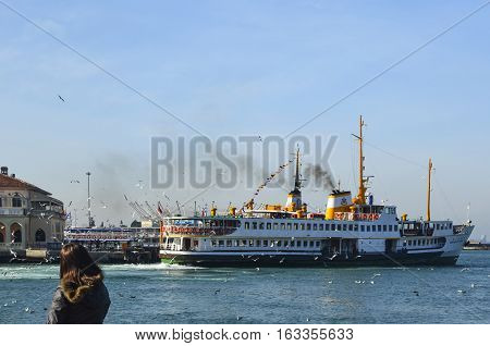 Istanbul Turkey - February 2 2014: Old Kadikoy Ferry Pier and Istanbul Ferries (called vapur in Turkish) continue to serve as a key public transport link for many Thousands of commuters tourists and vehicles per day.