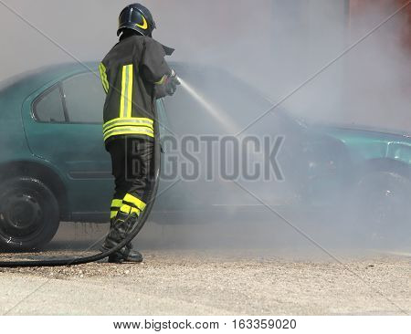 Fireman Extinguishes The Fire Of A Car