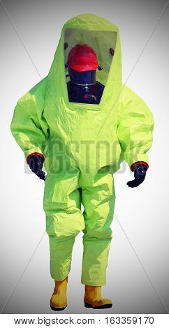 Person With Protective Overalls Against The Biohazard
