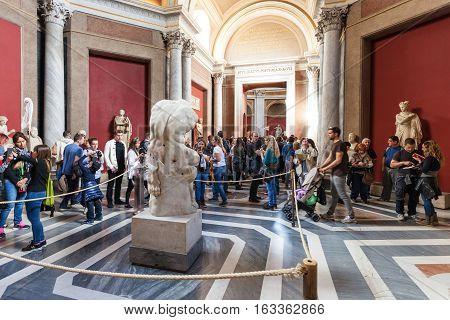 Visitors Near Ancient The Belvedere Torso Statue
