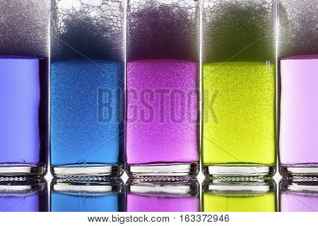 Color therapy. Brightly colored liquids or potions in glass bottles. Chemicals in neon colors.
