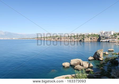 The Cliffs of Antalya as seen from Antalyas Oldtown Kaleici, with Konyaalti Beach and the Taurus Mountains in the Background