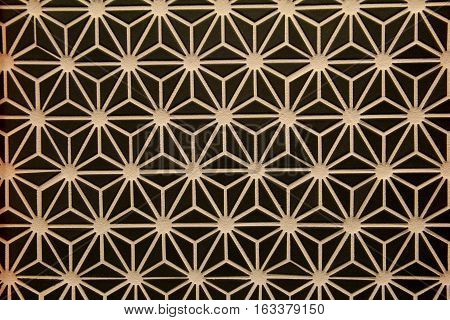 Interesting background of dark brown, with overlay of star design in tan color.