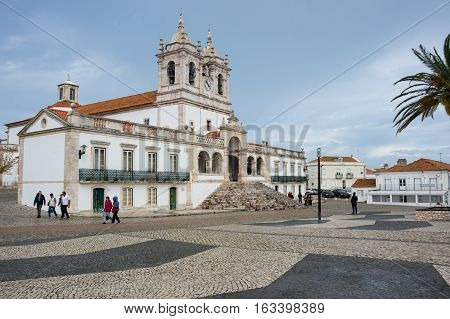 NAZARE PORTUGAL - OCTOBER 17 2015: The Church of Nossa Senhora da Nazare (Church of Our Lady of Nazare) is an imposing church located on the hilltop O Sitio overlooking Nazare Portugal