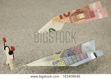 Air traffic controller directs flying money notes